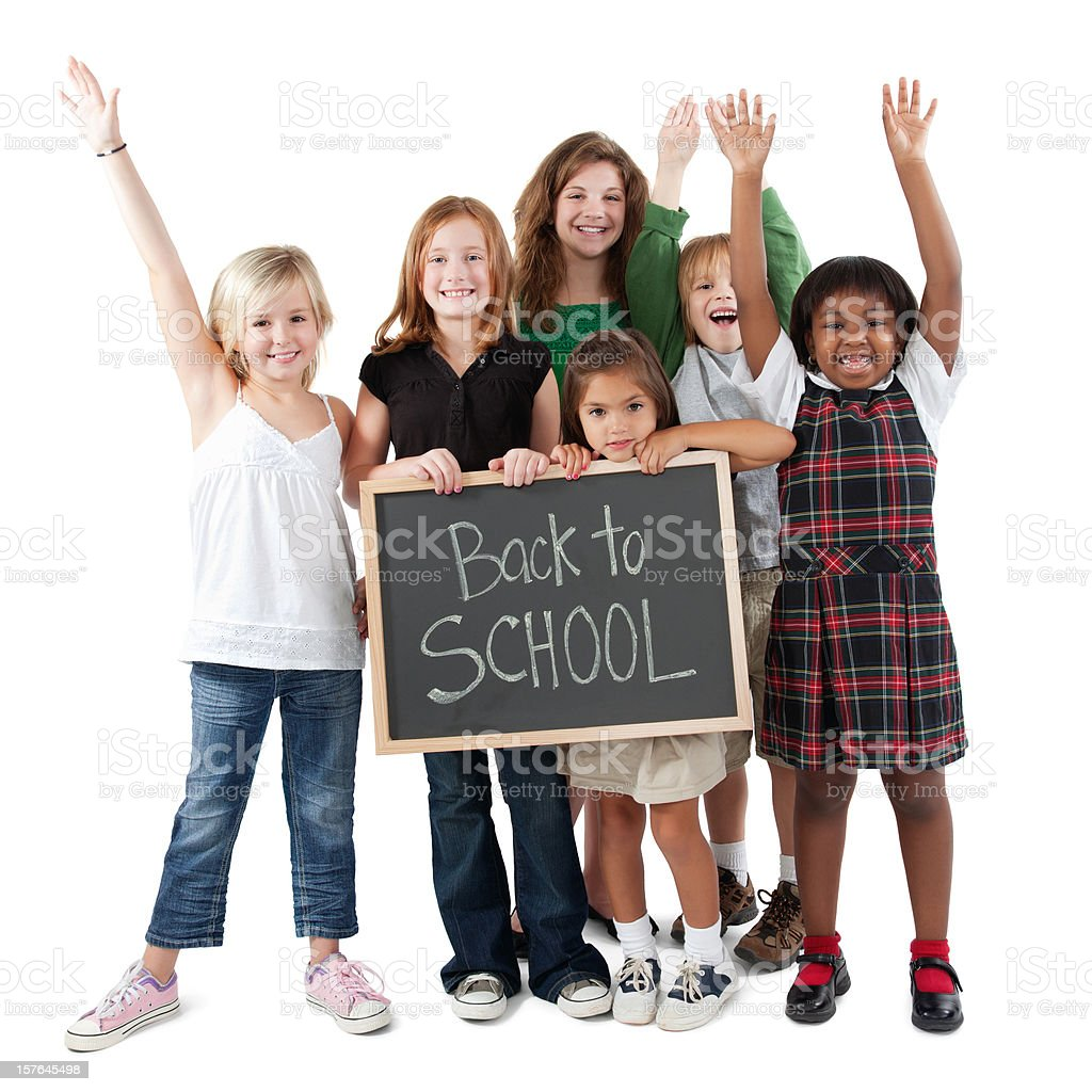 Happy Group of Students Holding Back To School Sign royalty-free stock photo