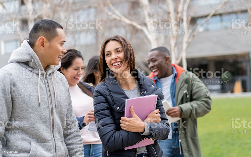 Happy group of students outdoors stock photo