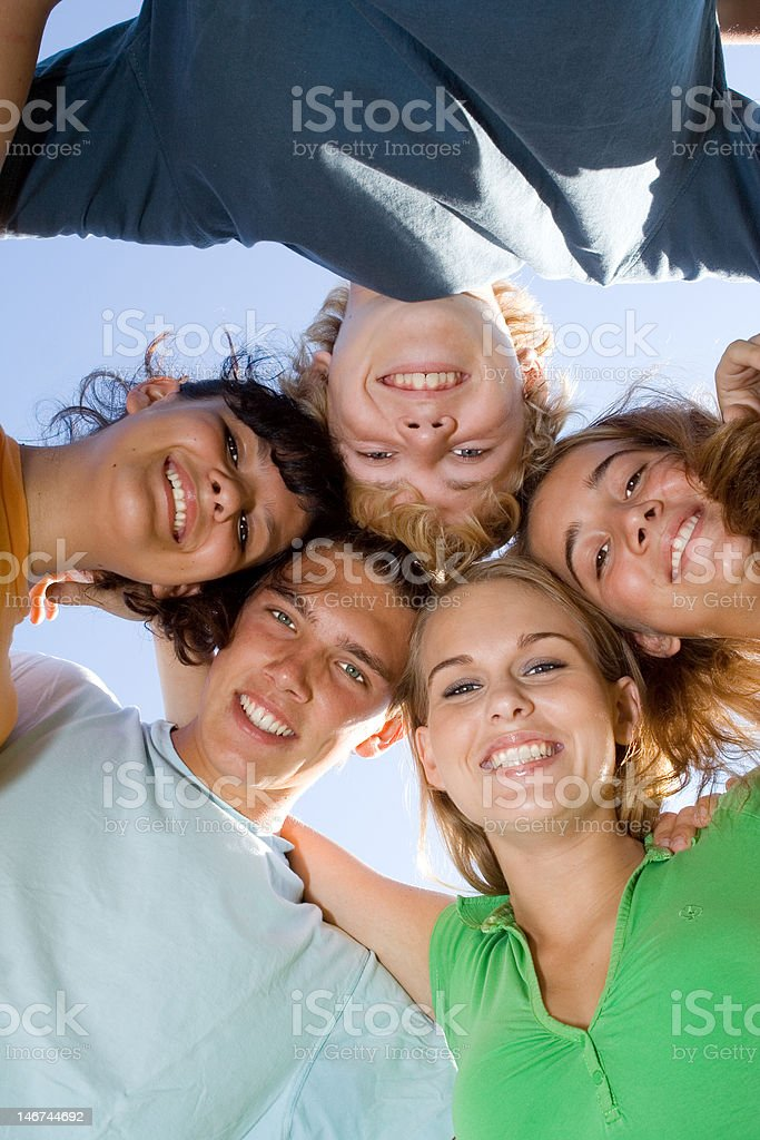 happy group of teens or youth with smiling faces stock photo