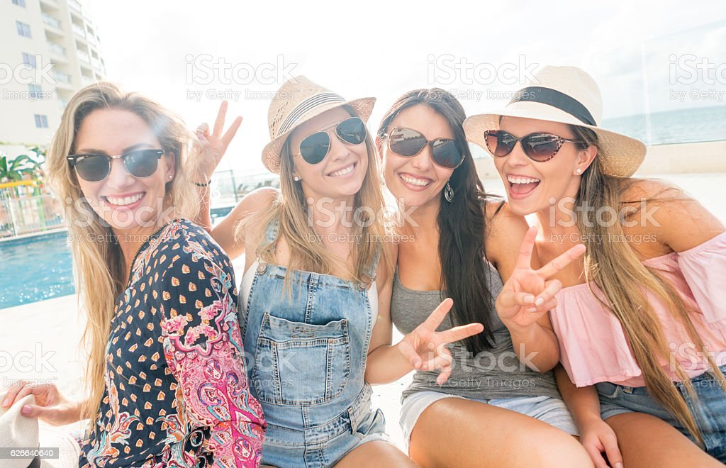 Happy group of women enjoying their vacations stock photo