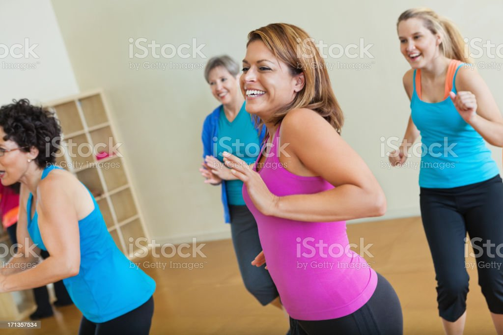 Happy group of women exercising together in fitness class royalty-free stock photo