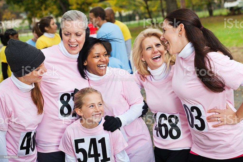 Happy group of women laughing together at charity even race royalty-free stock photo