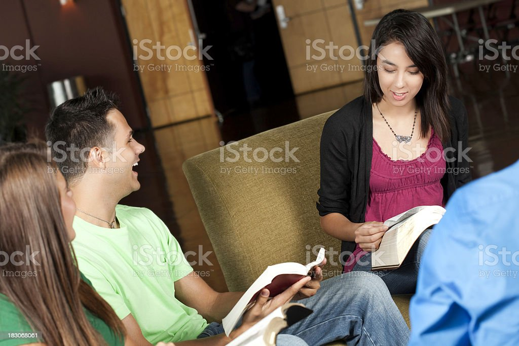 Happy Group of Young People Studying the Bible Together royalty-free stock photo