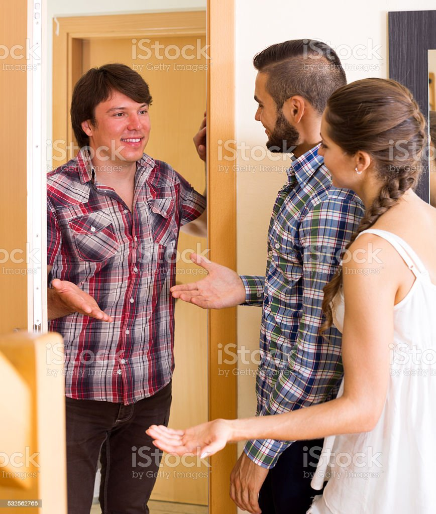 Happy guest saying hello stock photo