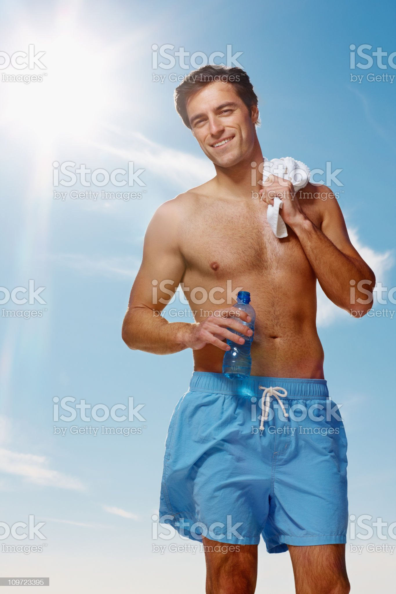 Happy guy against the blue sky after his workout royalty-free stock photo