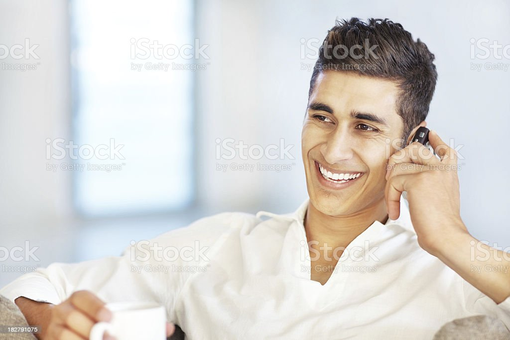 Happy guy speaking on cellphone and drinking coffee royalty-free stock photo