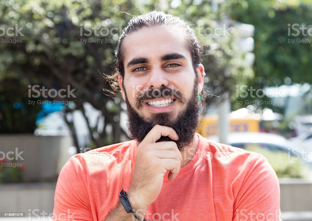 Happy guy with beard in the city stock photo