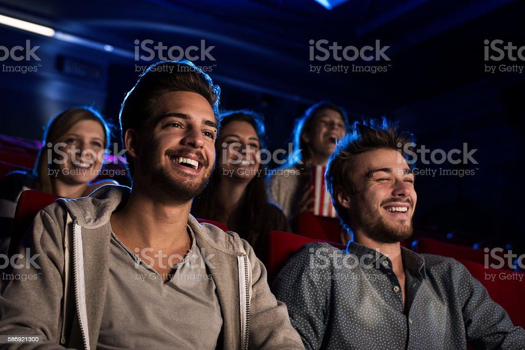 Happy guys at the cinema stock photo