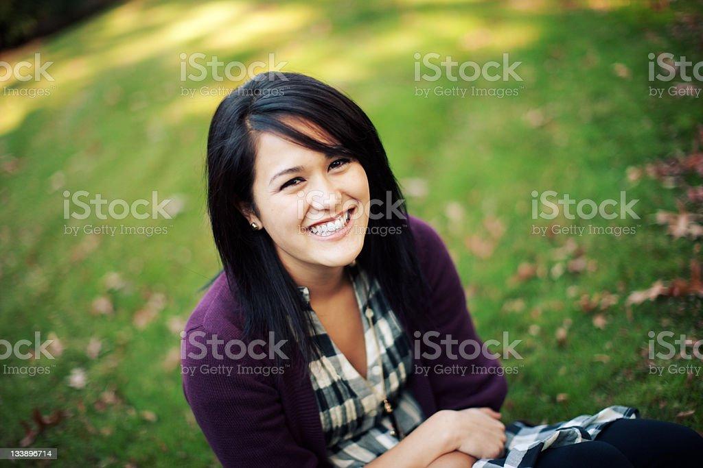 Happy Half Japanese Grass Sitting Woman royalty-free stock photo
