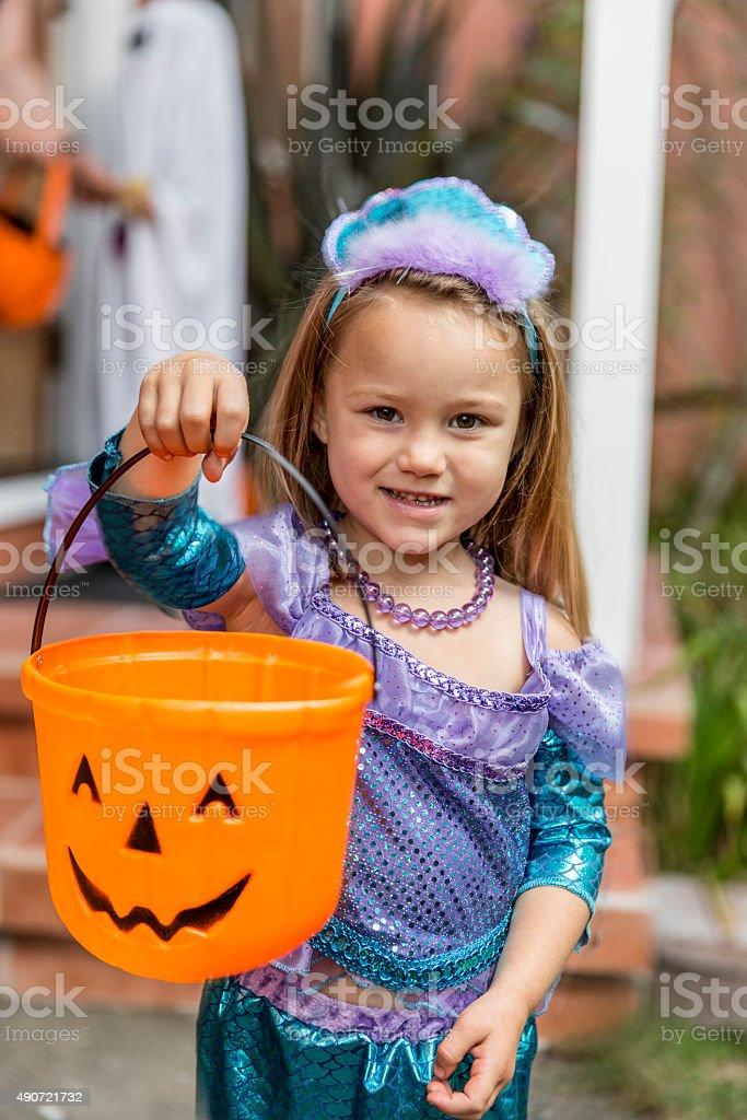 Happy Halloween: Little Mermaid Trick or Treating stock photo