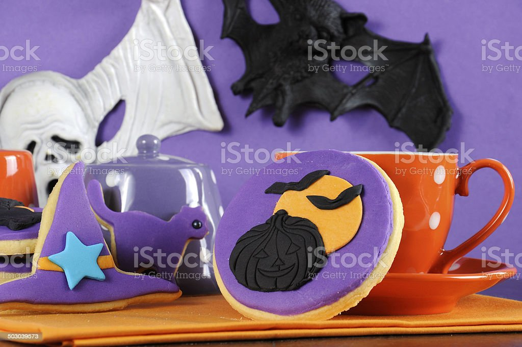 Happy Halloween party trick or treat purple and orange cookies royalty-free stock photo