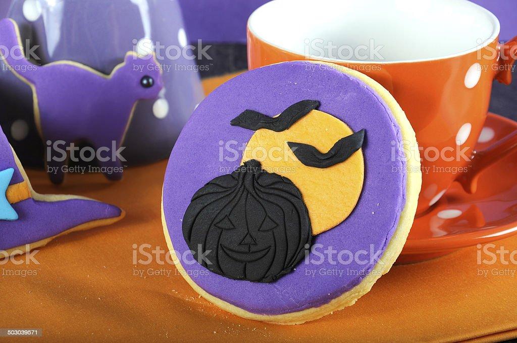 Happy Halloween trick treat purple and orange cookie close up royalty-free stock photo