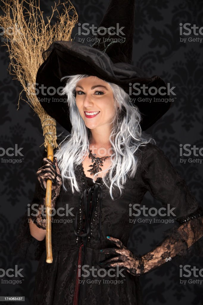 Happy Halloween Witch With Broom stock photo