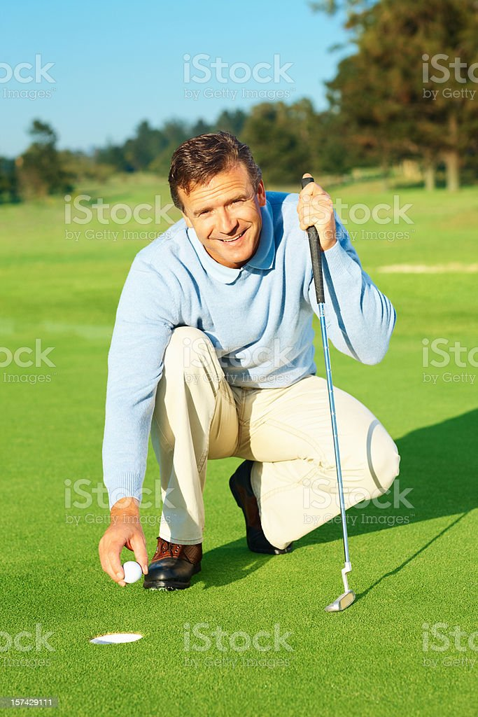 Happy handsome golfer during a game of golf royalty-free stock photo