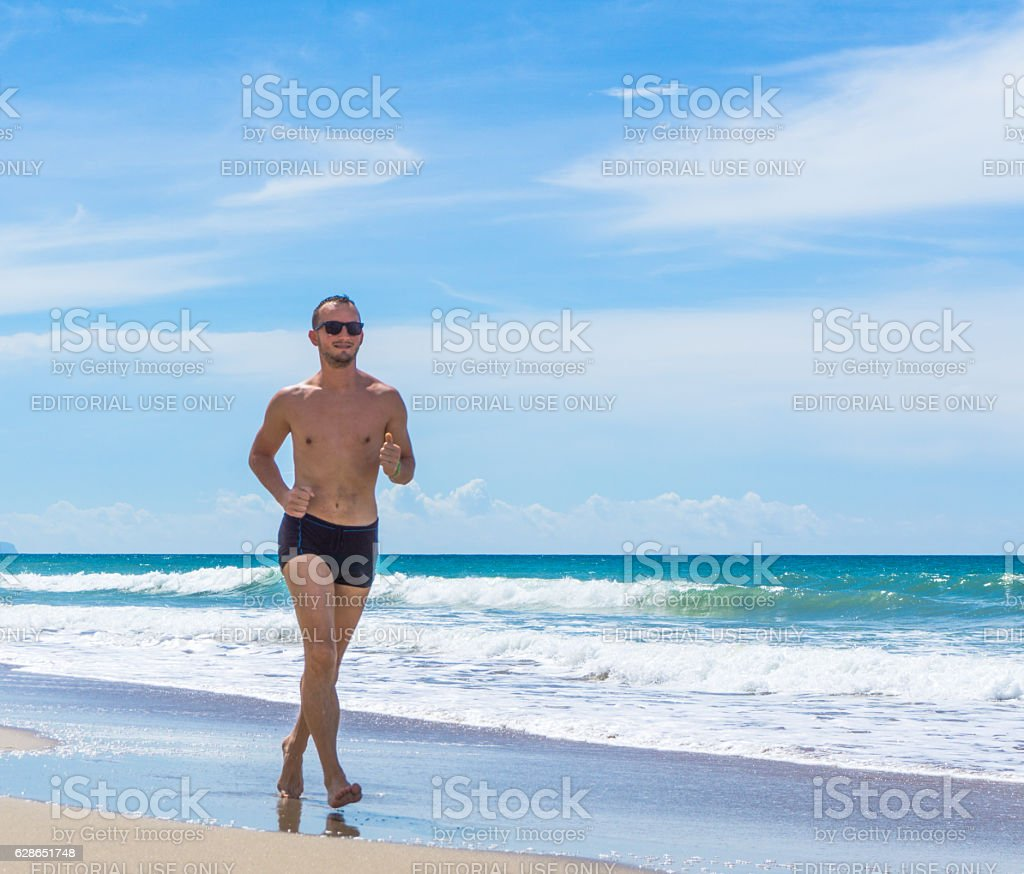 Happy Handsome Man Power Walking Sport Exercise Beach Thailand stock photo