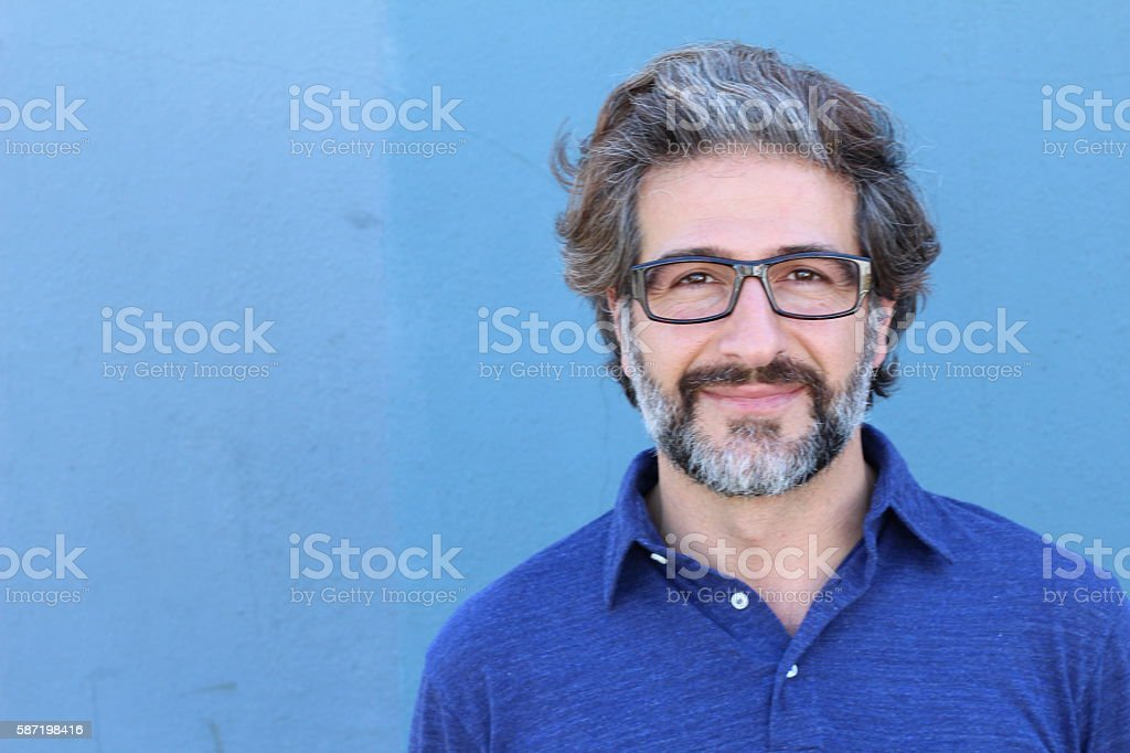 Happy handsome mature man with glasses stock photo