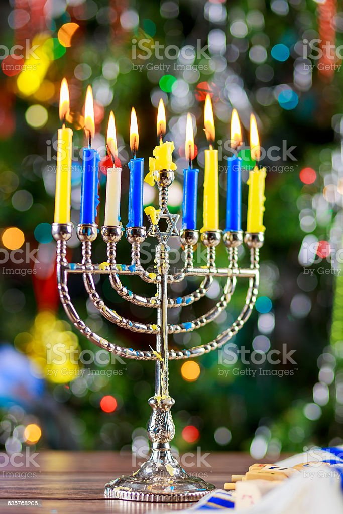 Happy Hanukkah. Low key image of jewish holiday with menorah stock photo