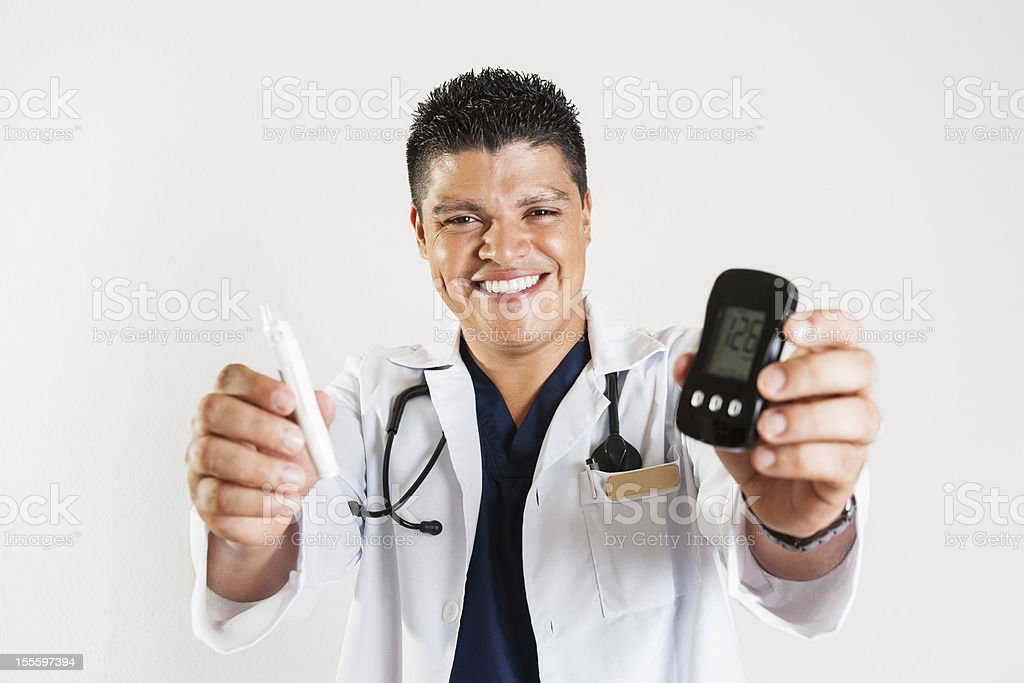 Happy health care professional (real) holding diabetes equipment. royalty-free stock photo