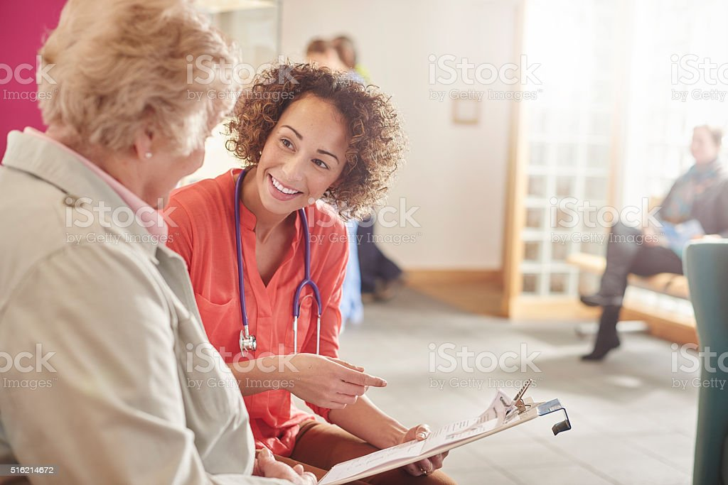 happy health senior with GP stock photo