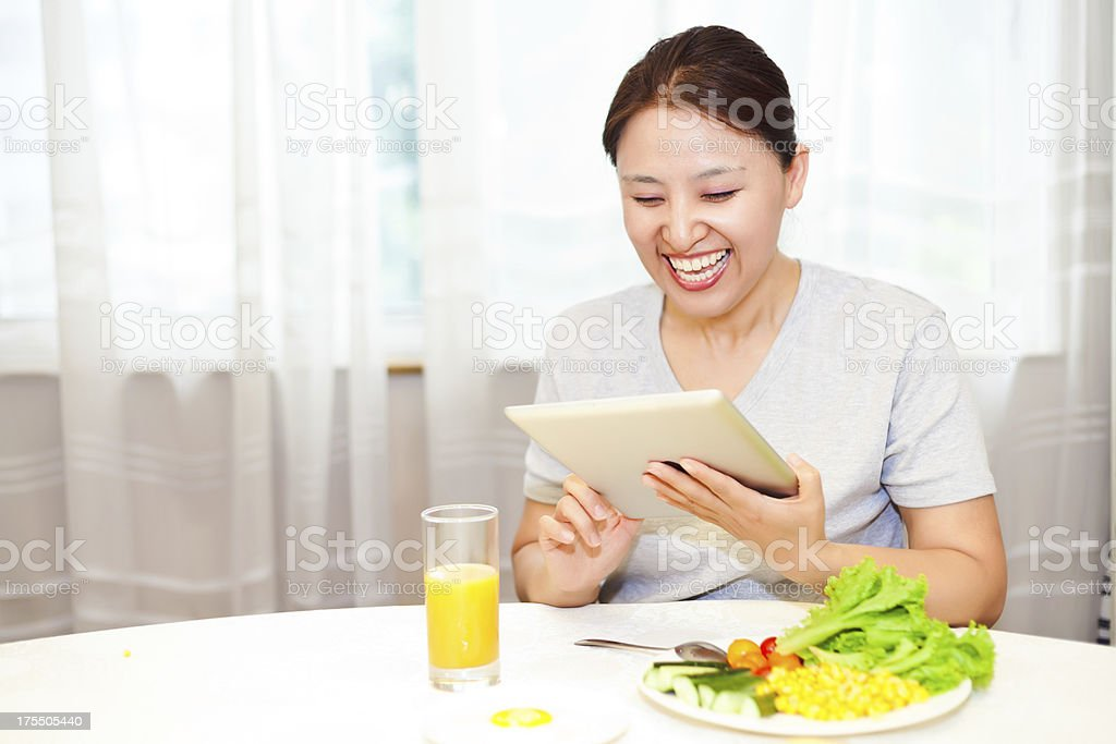 Happy healthy breakfast with tablet royalty-free stock photo