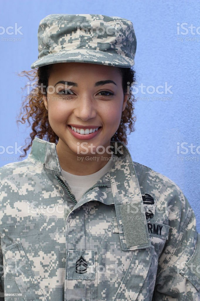 Happy healthy ethnic army female soldier stock photo
