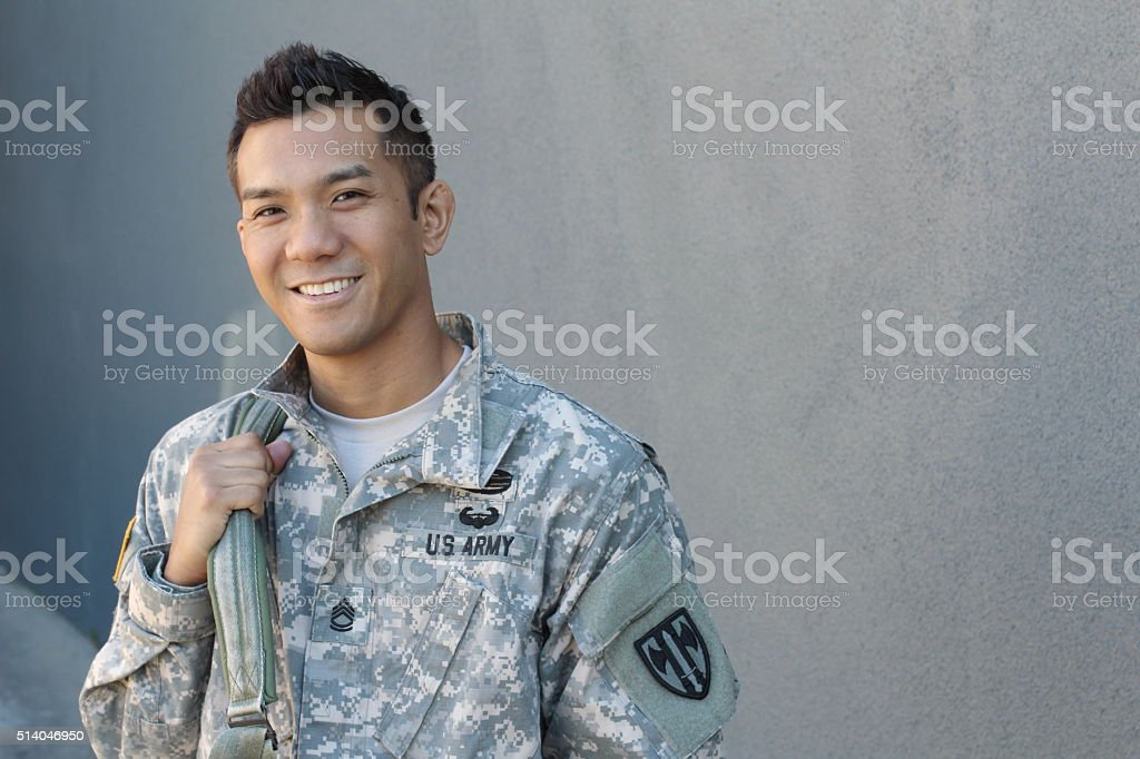 Happy healthy ethnic army soldier stock photo