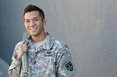 Happy healthy ethnic army soldier