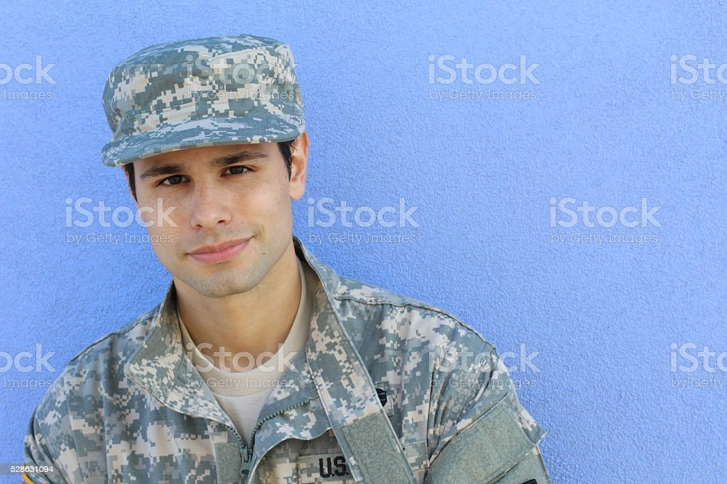 Happy healthy ethnic army soldier smiling stock photo