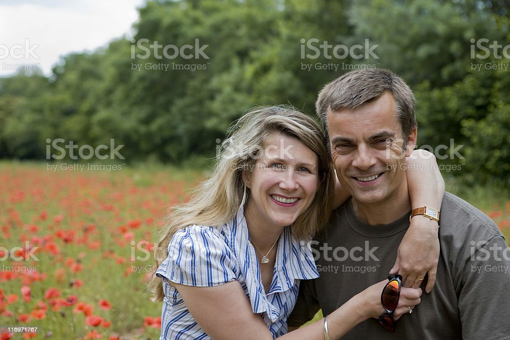 happy, healthy middle aged couple outdoors on walk royalty-free stock photo