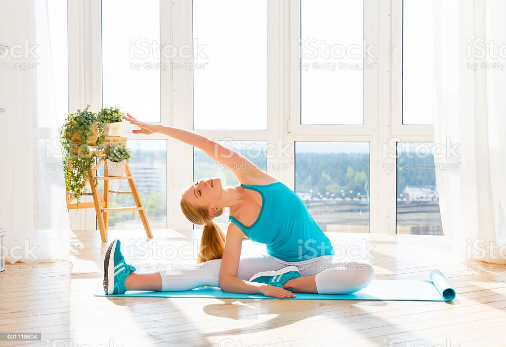 happy healthy woman practicing and engaged sports and fitness home