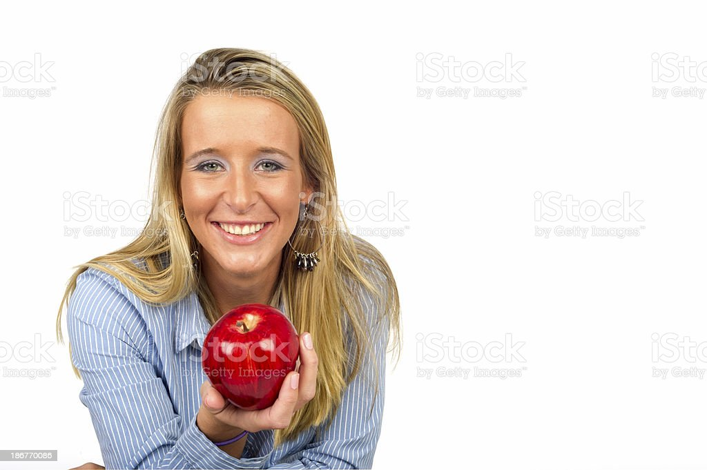 Happy, healthy young woman with an apple royalty-free stock photo