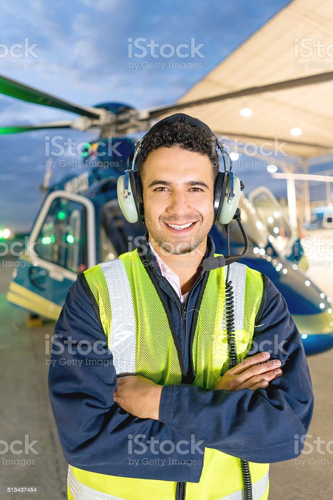 Happy helicopter pilot at the hangar stock photo