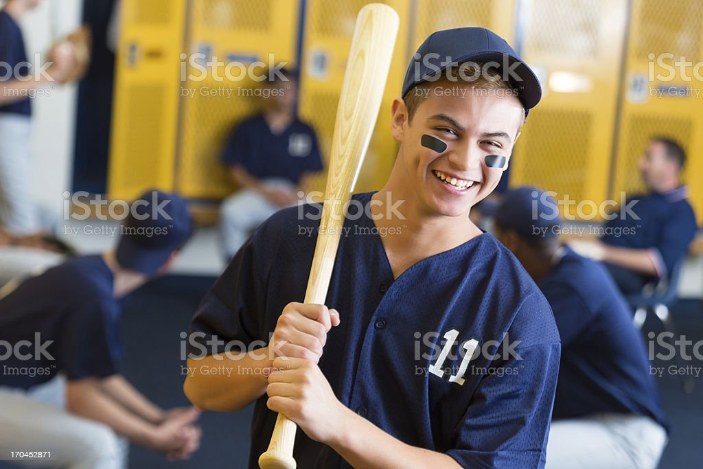 Happy high school athlete in locker room before baseball game royalty-free stock photo