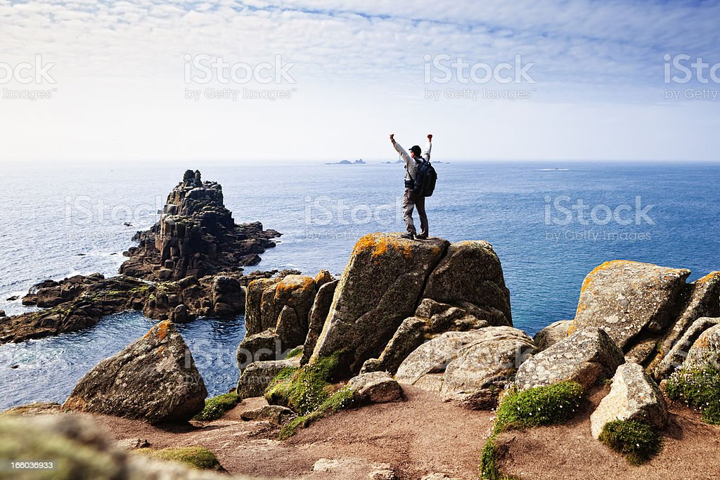 Happy hiker at Lands End, Cornwall stock photo