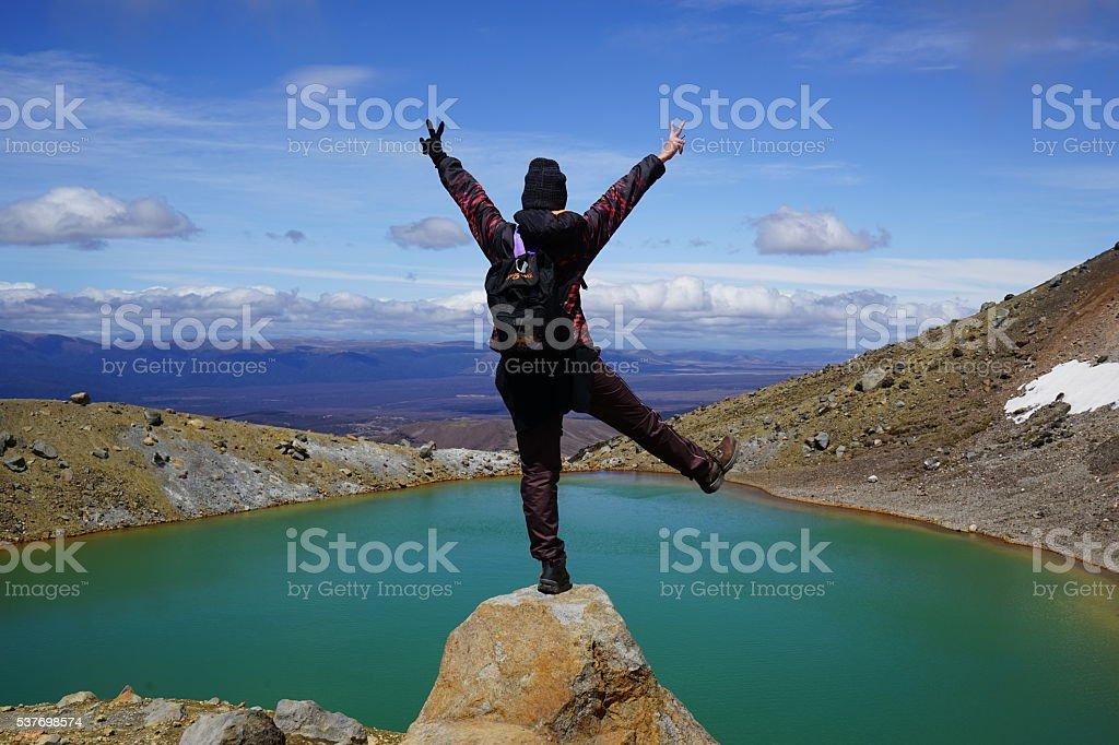 Happy hiker enjoying view at Tongarior, NZ stock photo