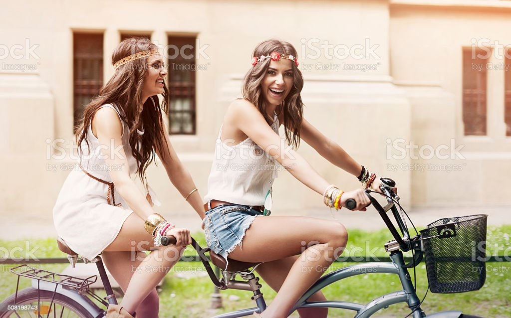 Happy hippie woman have fun on riding a tandem stock photo