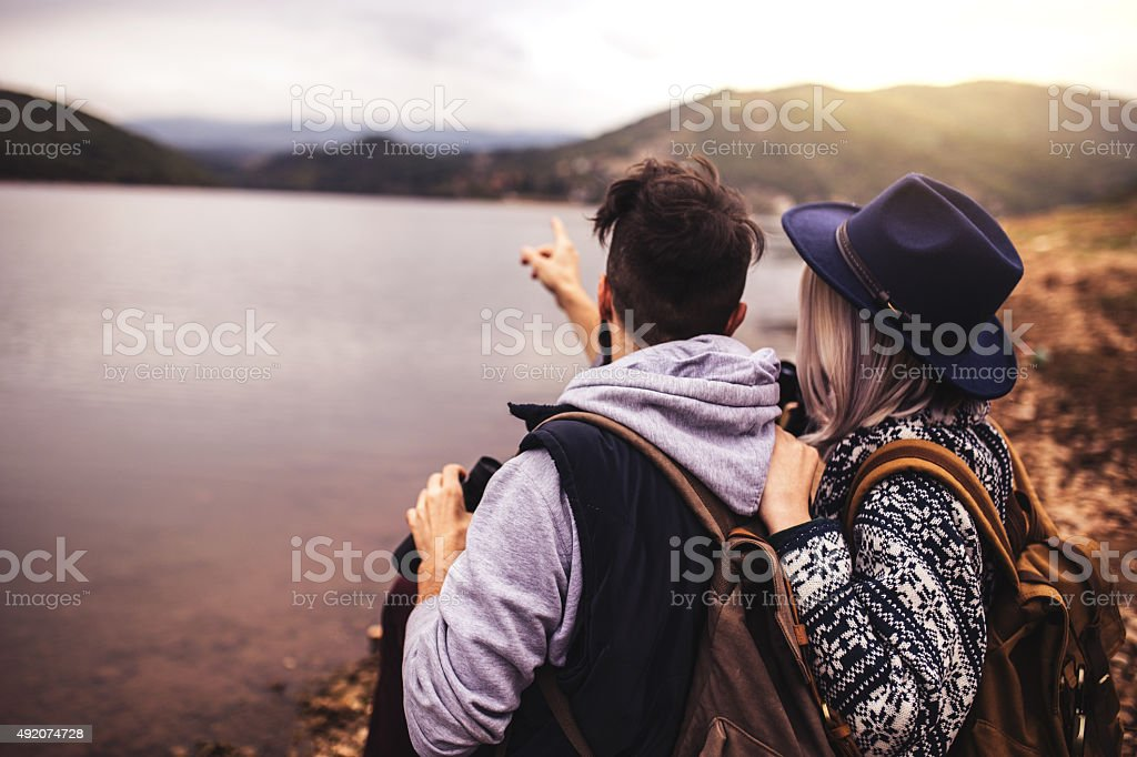 Happy hipster couple on an adventure stock photo
