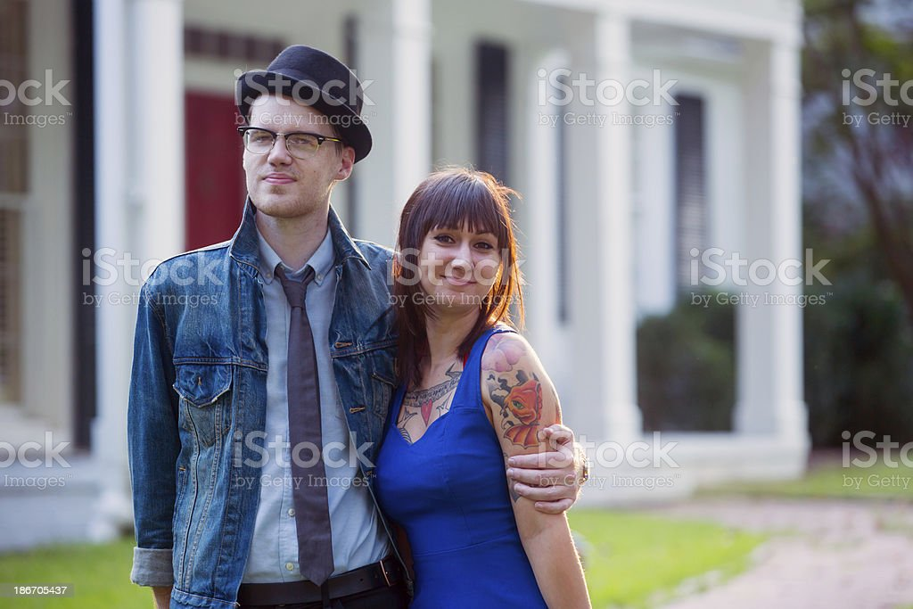 Happy Hipster Couple with House royalty-free stock photo