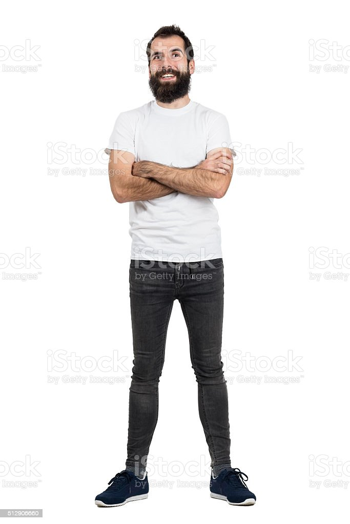 Happy hipster in white t-shirt and jeans with crossed arms stock photo