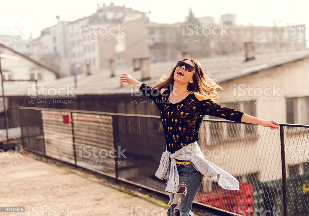 Happy hipster woman having fun on a terrace. stock photo