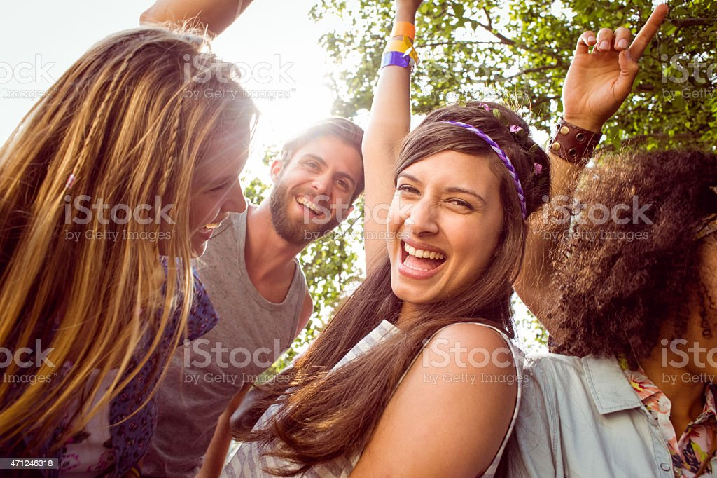 Happy hipsters dancing to the music stock photo