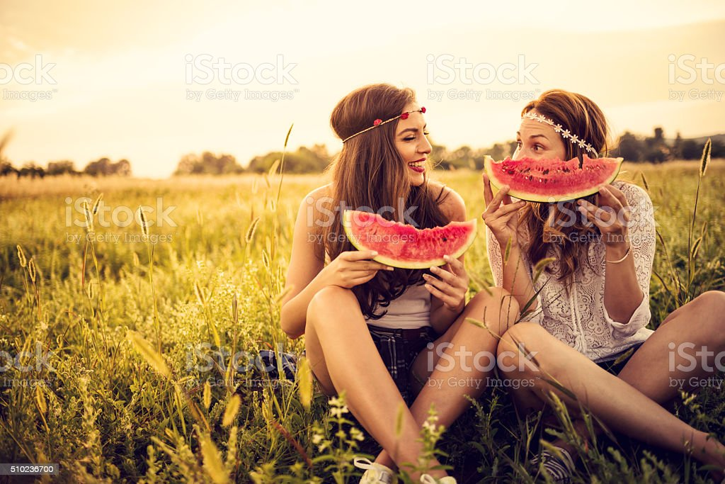 Happy hipsters in field stock photo