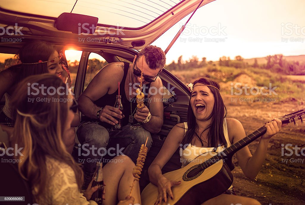 Happy hipsters on a road trip stock photo