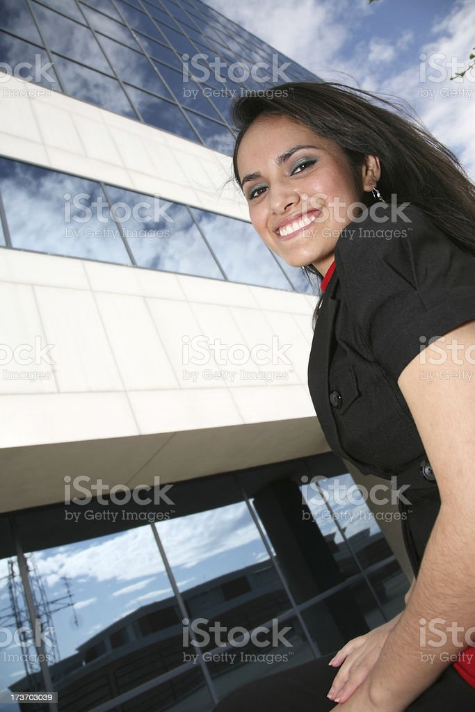 Happy Hispanic Business Woman In Front of Glass Office Building royalty-free stock photo