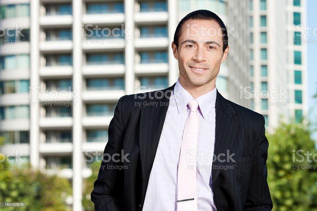 Happy, Hispanic Businessman Outside Buildings royalty-free stock photo