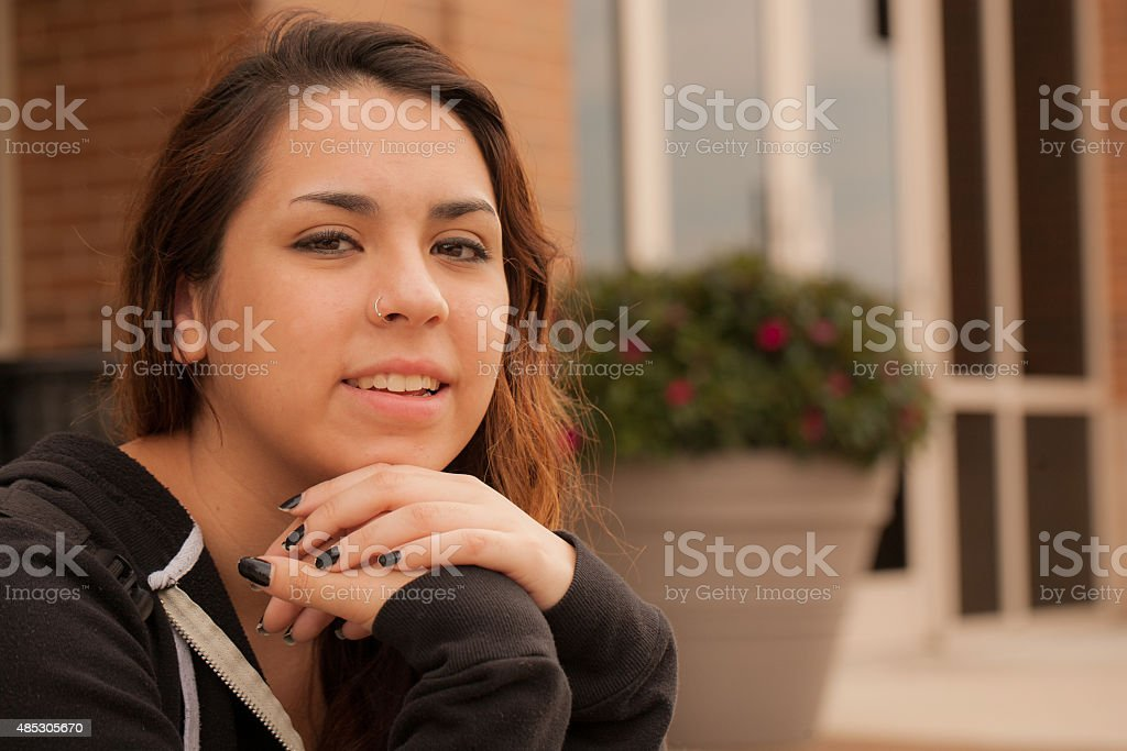 Happy Hispanic female college student stock photo
