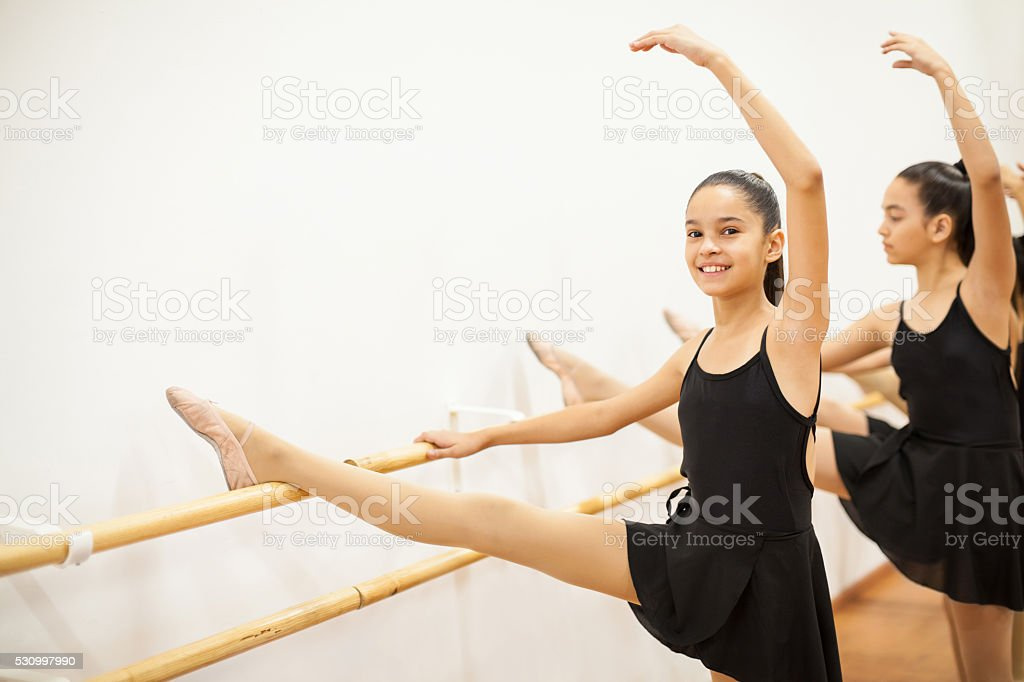 Happy Hispanic girls in a dance class stock photo