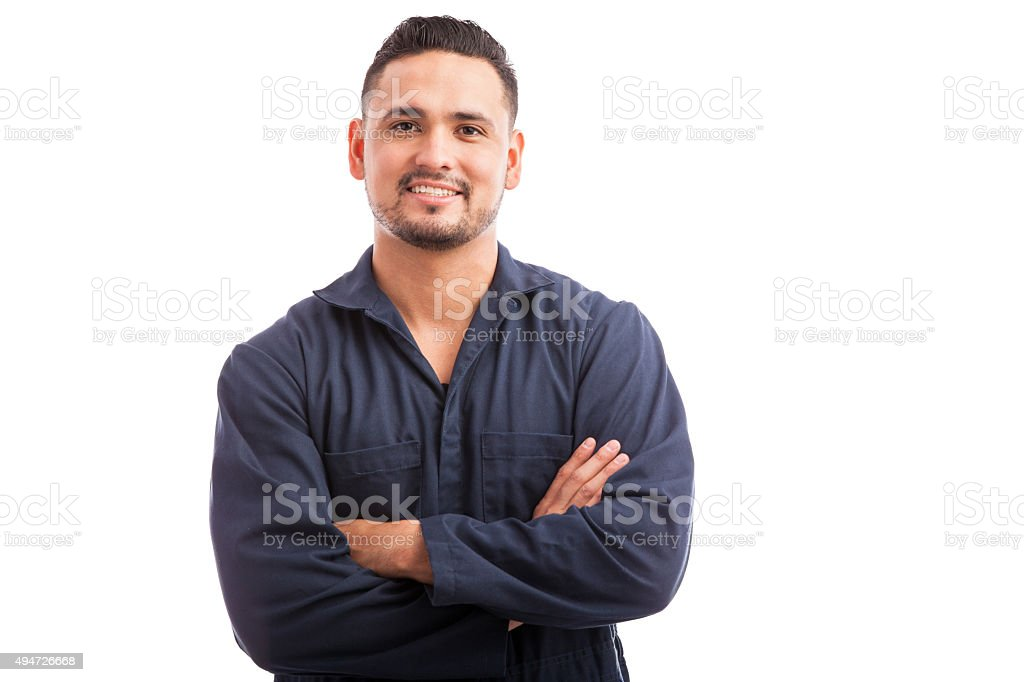 Happy Hispanic mechanic stock photo