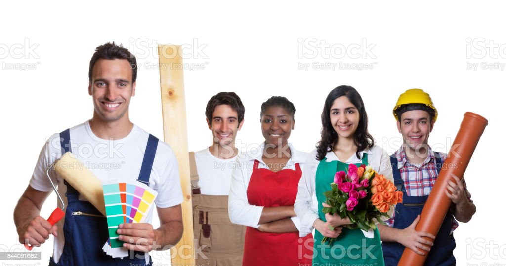 Happy hispanic painter with group of other international apprentices stock photo