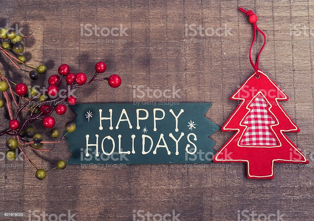 happy Holiday written on wooden background stock photo